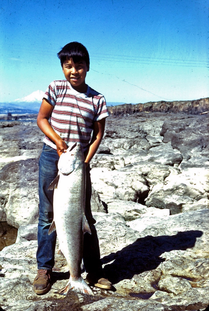 boy with chinook at celilo falls