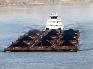 A barge transporting coal on a river.