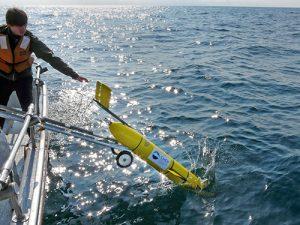 Ocean drone being deployed into Pacific Ocean